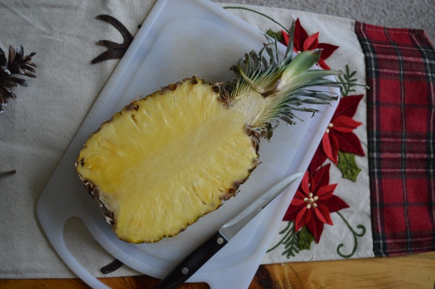 Half a pineapple ready to eat.