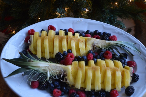 Pineapple on a platter with berries